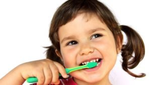 Young girl brushing her teeth 1050x700 300x169 - Bet You Never Knew THIS Use For Toothbrushes!