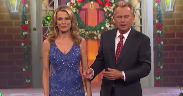 wof 1 1.jpg?resize=412,232 - Vanna White's Hilarious Wardrobe Malfunction! The Wheel Of Fortune Hostess Walked Around With Gift Attached To Her Dress