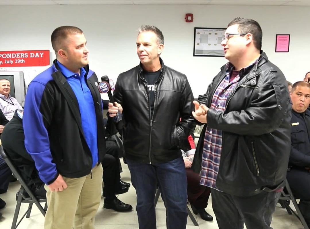 Deputy Matt Holman (Left) beiing interviewed about the story by HIS Radio Image Credit: Instagram
