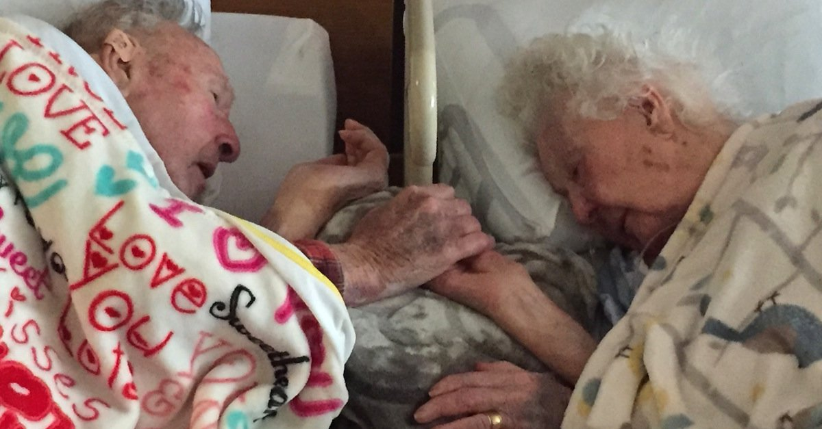 thumbaelderlycouple.jpg?resize=412,232 - Century Old Man Holds His Wife's Hand as She Passes On