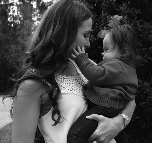 Courtney and her beautiful baby Emmy. Image via Parker Myles