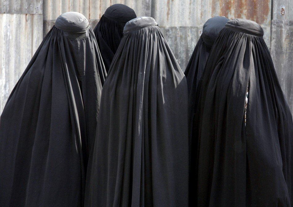 Several women in burkas. Image Credit: Reuters
