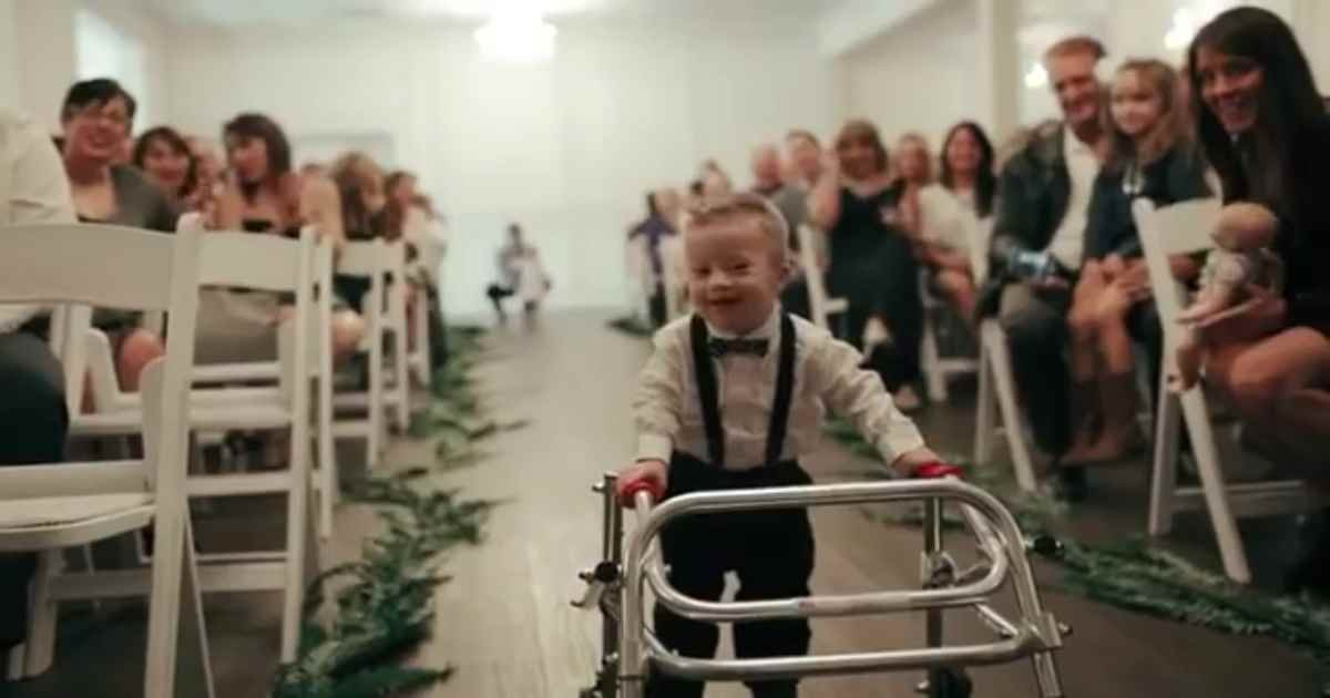 baby aisle surprise.jpg?resize=1200,630 - Young Ring Bearer With Down Syndrome Proudly Walked Down The Aisle