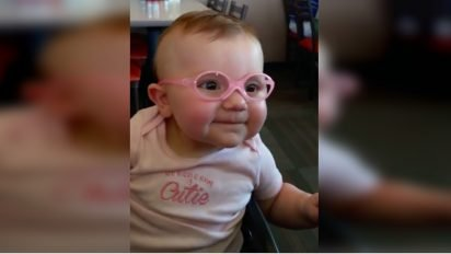 glasses 412x232.jpg?resize=412,232 - Baby Couldn't Stop Smiling After Wearing Eyeglasses And Seeing Properly For The First Time