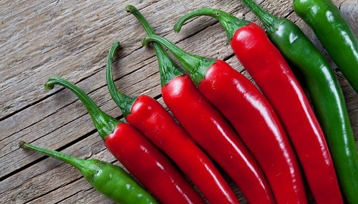 Fresh Red and Green Chili Pepper on wooden board