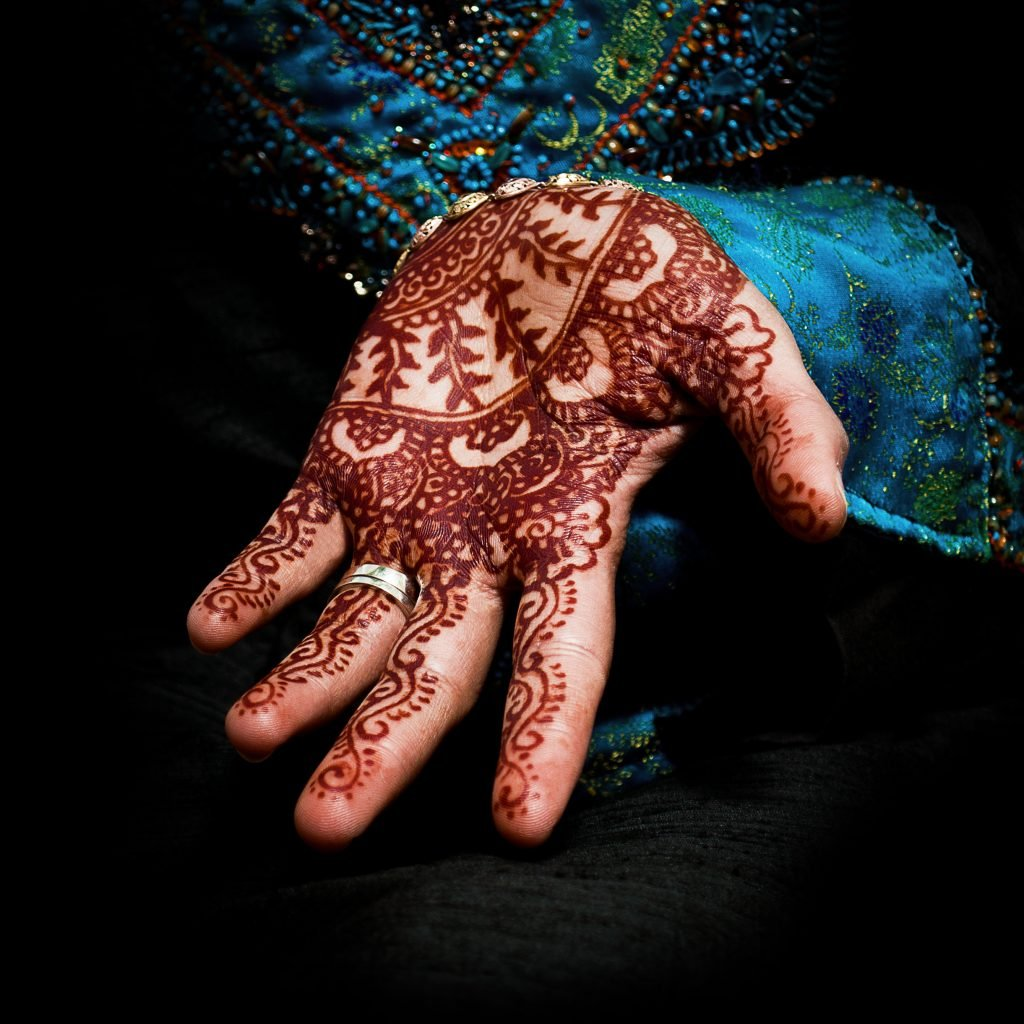 Henna, mehendi on a bride's hand - fun square