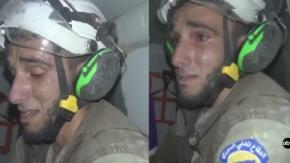 rescue worker saves baby 412x232.jpg?resize=412,232 - Rescue Worker Broke Into Tears As He Pulled A Baby From Rubble In Syria During The War