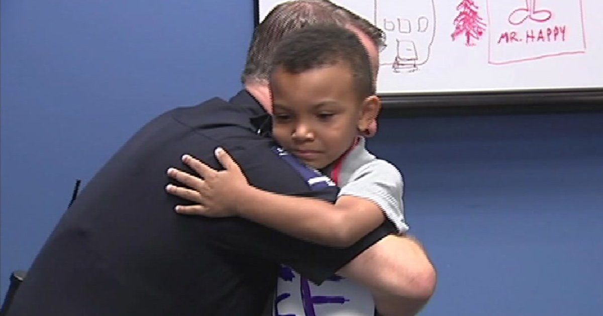 boy sign walks police cover 1.jpg?resize=412,232 - 5-Year-Old Boy Walked In Police Station Offering Free Hugs To Officers Amid Tensions Within The Community