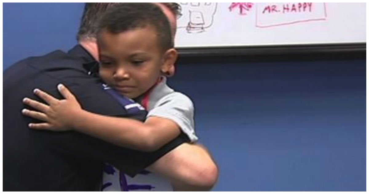 boy sign walks police cover - 5-Year-Old Boy Walks In With Sign Around His Neck. Next, Cops Quickly Reads It And Runs Over In Tears