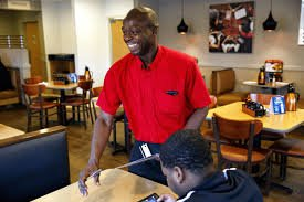 Pictured above is Johann, warmly welcoming customers to IHOP.