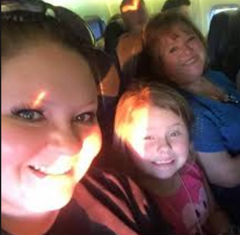 Pictured above is Sabrina, her daughter, and her mom before the accident.
