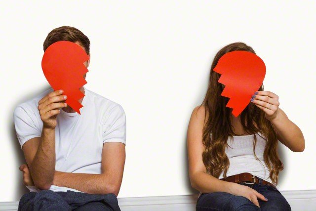 27 Jun 2014 --- Young couple holding broken heart over white background --- Image by © Wavebreak Media LTD/Wavebreak Media Ltd./Corbis