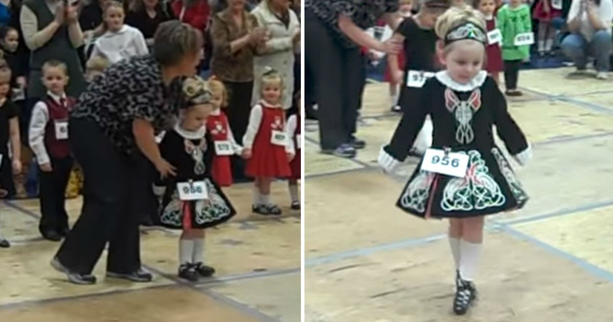 baby girl onstage.jpg?resize=300,169 - Tiny Girl Walks Onstage With Teacher's Help, But Her Quick Stepping Doesn't Need Any Help!