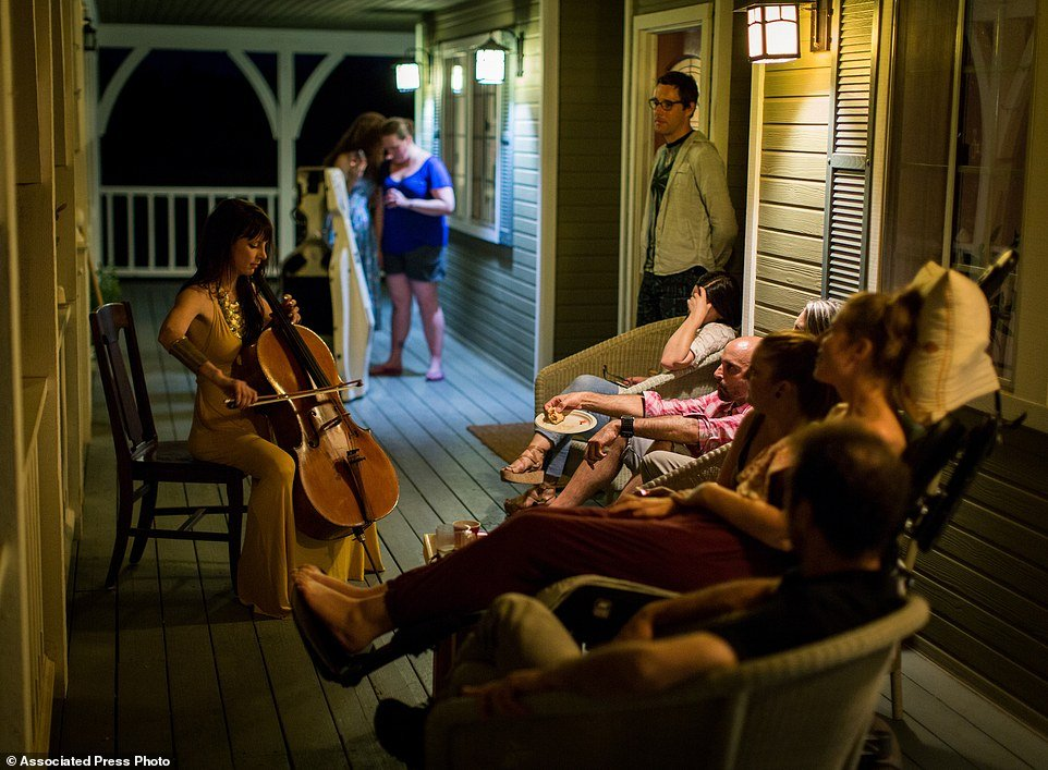"This July 23, 2016 photo provided by Niels Alpert, Kestrin Pantera plays her chello at a going away party for her friend Betsy Davis in Ojai, Calif. In early July, Davis emailed her closest friends and family to invite them to a two-day celebration, telling them: ""These circumstances are unlike any party you have attended before, requiring emotional stamina, centeredness, and openness. And one rule: No crying."" The 41-year-old woman diagnosed with ALS, held the party to say goodbye before becoming one of the first California residents to take life-ending drugs under a new law that gave such an option to the terminally ill. (Niels Alpert via AP)"