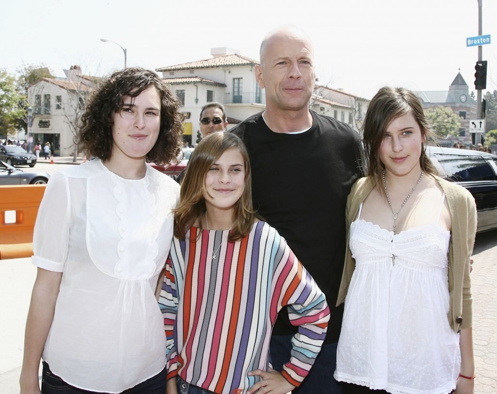 """LOS ANGELES - APRIL 30: Actor Bruce Willis and his daughters Rumer, Tallulah and Scout arrive at the premiere of DreamWorks' """"Over The Hedge"""" at the Village Theater on April 30, 2006 in Los Angeles, California. (Photo by Kevin Winter/Getty Images)"""