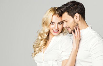 Portrait of blond smiling woman with white teeth and handsome man