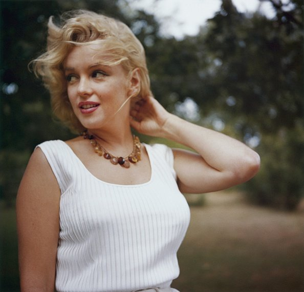AMAGANSETT, NY - 1957: Marilyn Monroe poses wearing an amber bead necklace in 1957 in Amagansett, New York. (Photo by Sam Shaw/Shaw Family Archives/Getty Images)