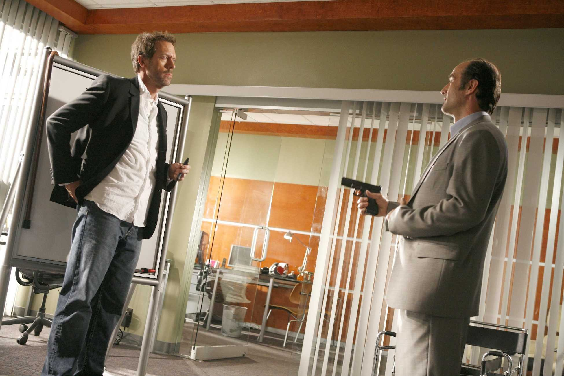 "HOUSE: House (Hugh Laurie, L) is shot by a disgruntled former patient (Elias Koteas, R) in the HOUSE season finale episode ""No Reason"" airing Tuesday, May 23 (9:00-10:00 PM ET/PT) on FOX. ©2006 Fox Broadcasting Co. Cr: Isabella Vosmikova/FOX"