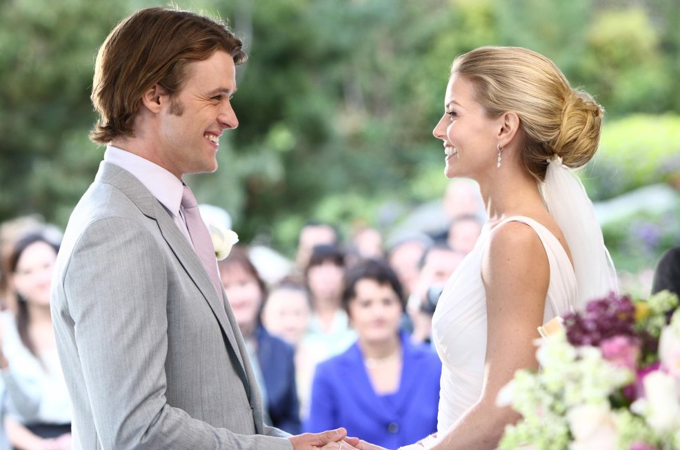 "HOUSE: Chase (Jesse Spencer, L) and Cameron (Jennifer Morrison, R) exchange vows at their wedding in the HOUSE season finale episode ""Both Sides Now"" that aired Monday, May 11 (8:00-9:00 PM ET/PT) on FOX. ©2009 Fox Broadcasting Co. Cr: Justin Lubin/NBC Universal/FOX"