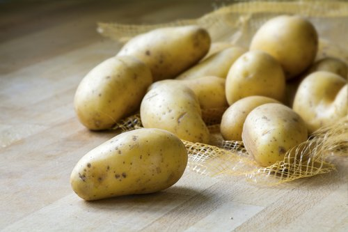 new potatoes on a wooden kitchen board