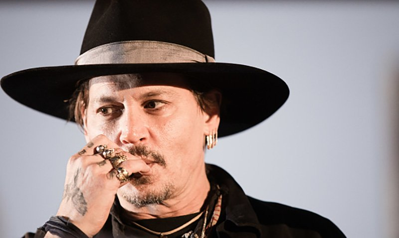 """GLASTONBURY, ENGLAND - JUNE 22: American actor Johnny Depp introduces his film """"The Libertine"""" on day 1 of the Glastonbury Festival 2017 at Worthy Farm, Pilton on June 22, 2017 in Glastonbury, England. (Photo by Ki Price/Getty Images)"""