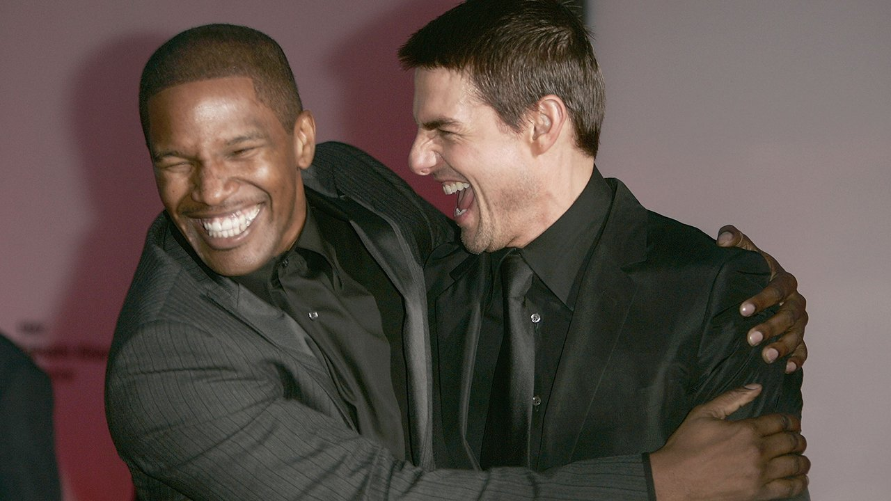 """VENICE, ITALY - SEPTEMBER 3: Actors Jamie Foxx (L) and Tom Cruise attend the """"Collateral"""" Premiere at the 61st Venice Film Festival on September 3, 2004 in Venice, Italy. (Photo by Pascal Le Segretain/Getty Images)"""