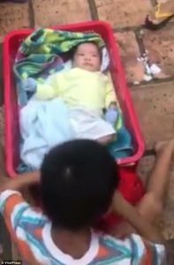 4178f8b100000578-4611540-the_baby_s_six_year_old_brother_was_found_sitting_next_to_him_in-m-40_1497629933143