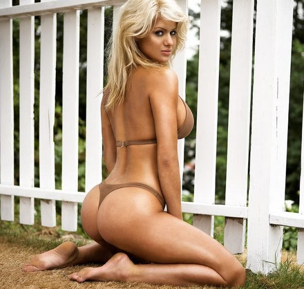 5569-a-beautiful-blond-posing-in-a-bikini-by-a-white-fence-or