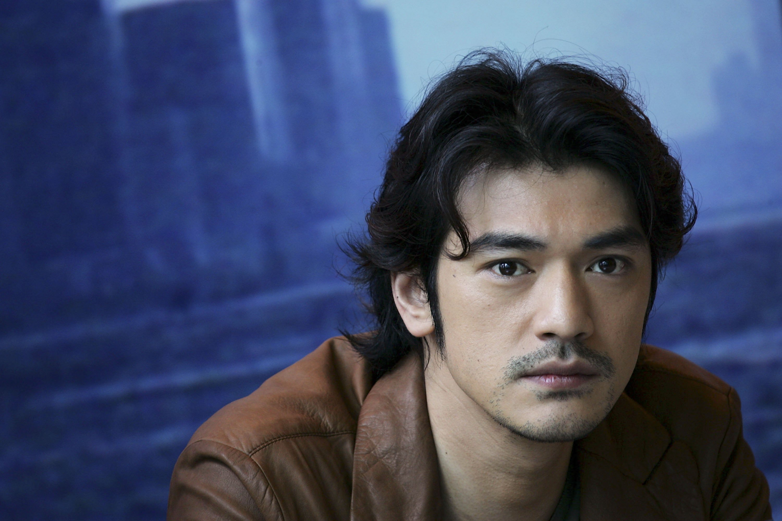 "HONG KONG - JULY 09:  Movie star Takeshi Kaneshiro attends a press conference and photocall to promote the new movie titled ""Confession of Pain"" on July 9, 2006 in Hong Kong, China.  (Photo by MN Chan/Getty Images)"
