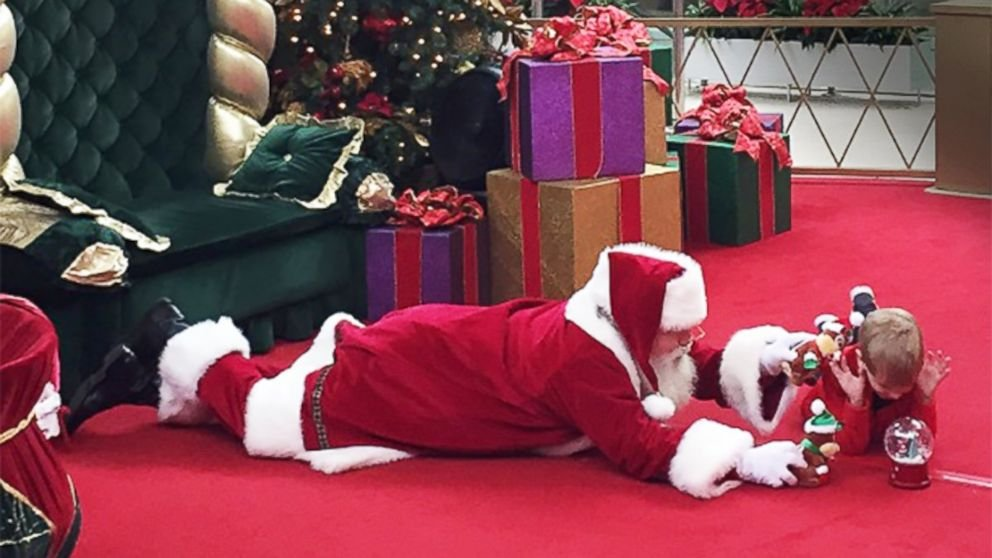 Image result for brayden deely Kid With Autism Finally Gets Photo With Santa, His Happiness is Priceless