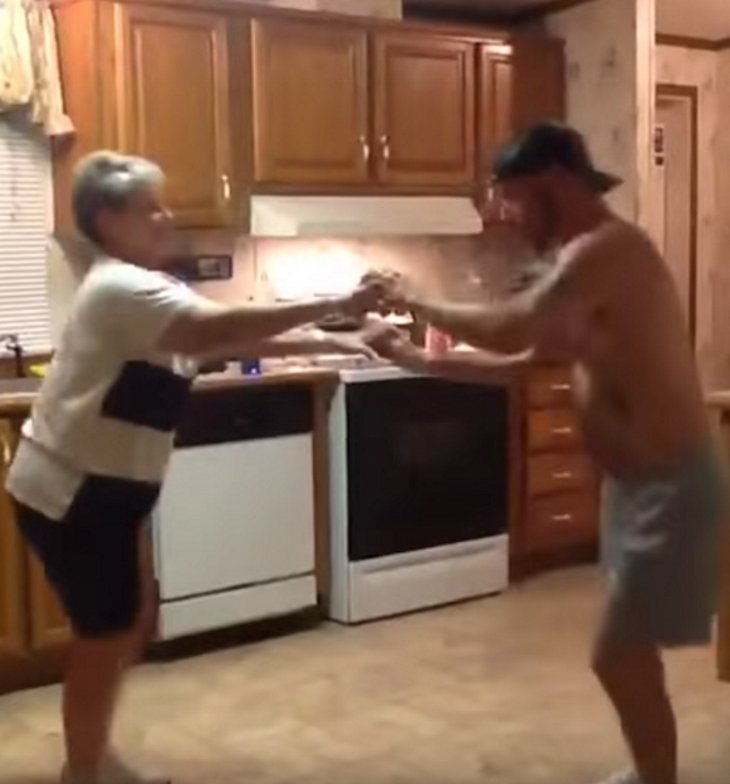 momsonhands - Son Grabs Mom's Hand When Their Favorite Song Comes On, Their Dance Blows Up The Internet