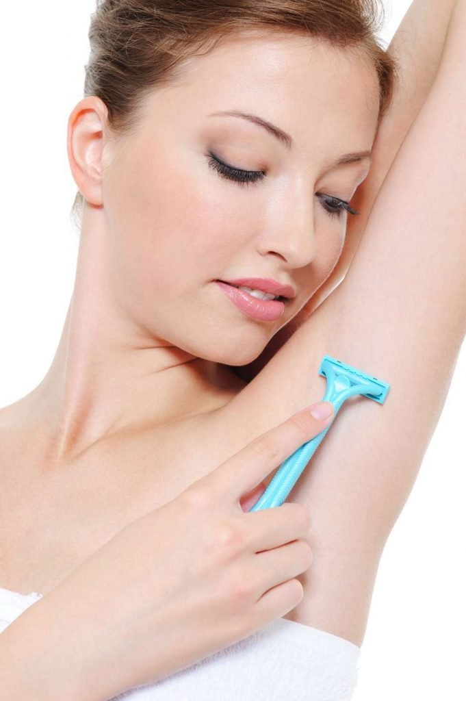 depositphotos_94078372-stock-photo-woman-shaving-armpit-with-razor