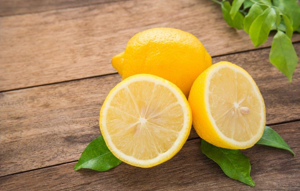 Fresh lemons on wooden table