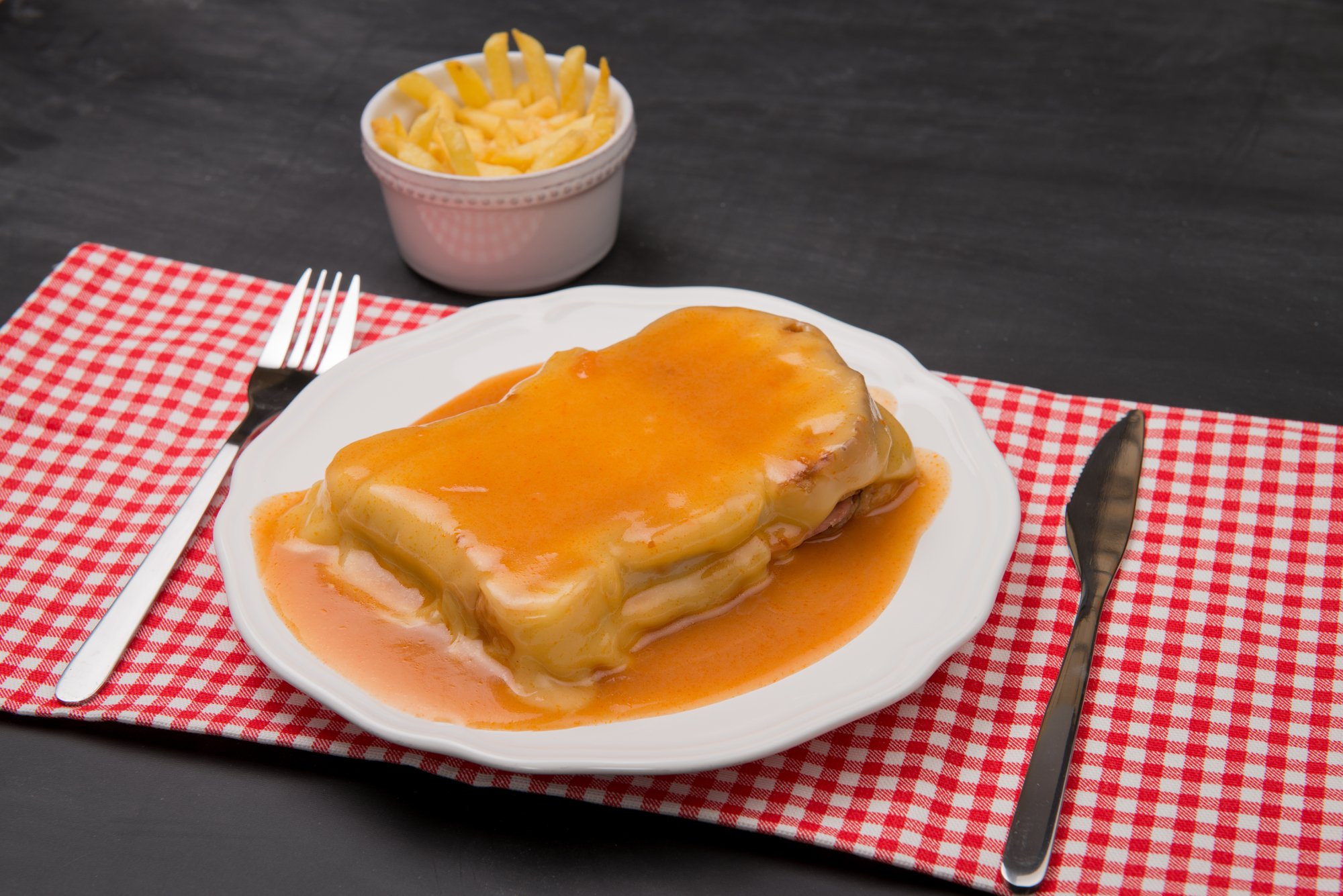 Francesinha and french fries, typical food from Porto, Portugal