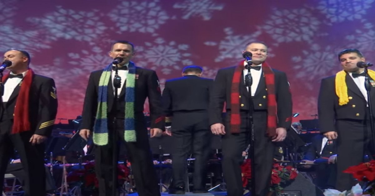 navyband 1.png?resize=300,169 - Navy Band Performs White Christmas, Man In Yellow Scarf Surprises The Crowd With His Voice