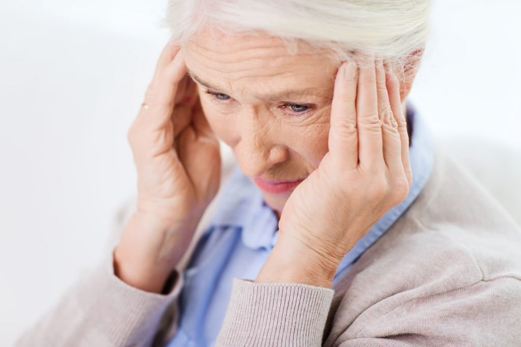 51810652 - face of senior woman suffering from headache