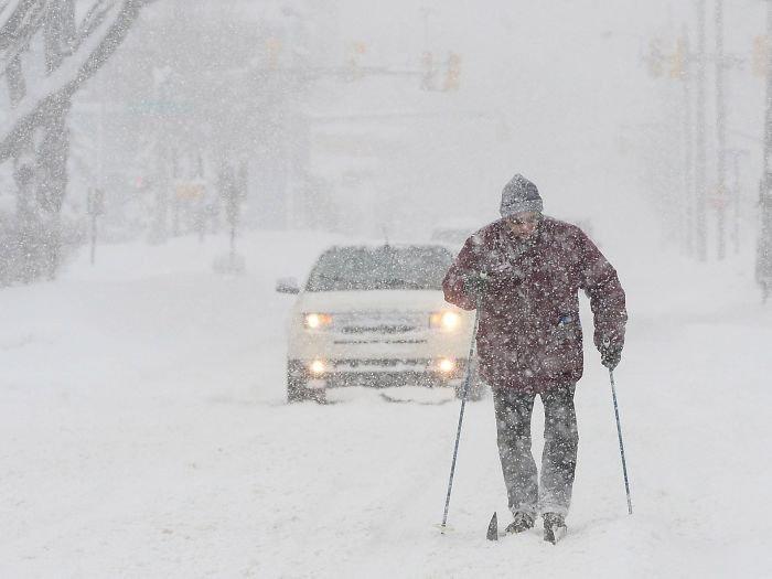 Man Skis On A Street