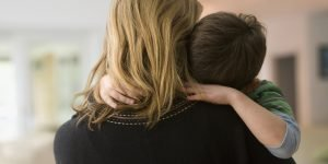 Caucasian mother comforting son