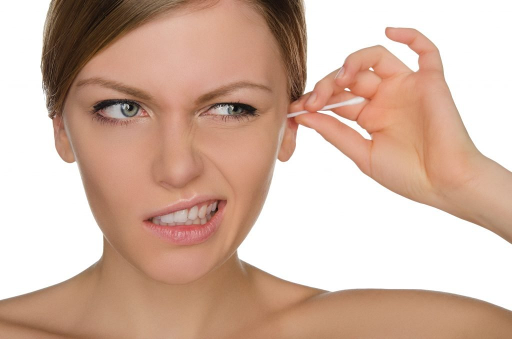 41978862 - woman injured cleans ears with cotton sticks isolated on white
