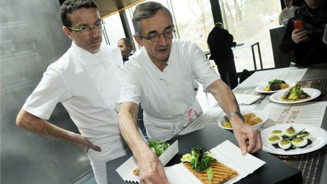 French chef Michel Bras and his son Sebastien present a dish at Bras