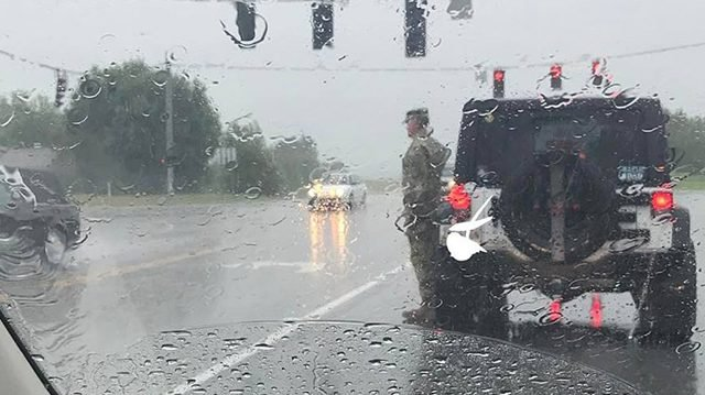 soldier.jpg?resize=412,232 - Solider Salutes Stranger's Funeral Procession Under Heavy Rain