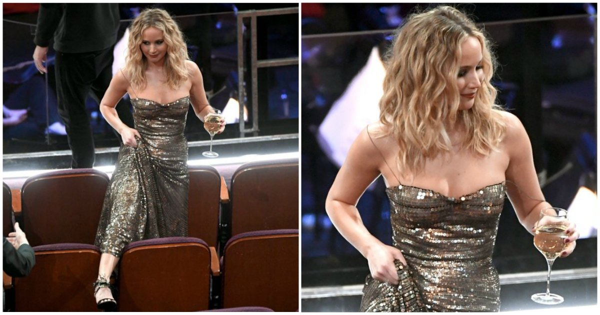 3 199 - On est un peu tous Jennifer Lawrence enjambant des fauteuils un verre de vin à la main