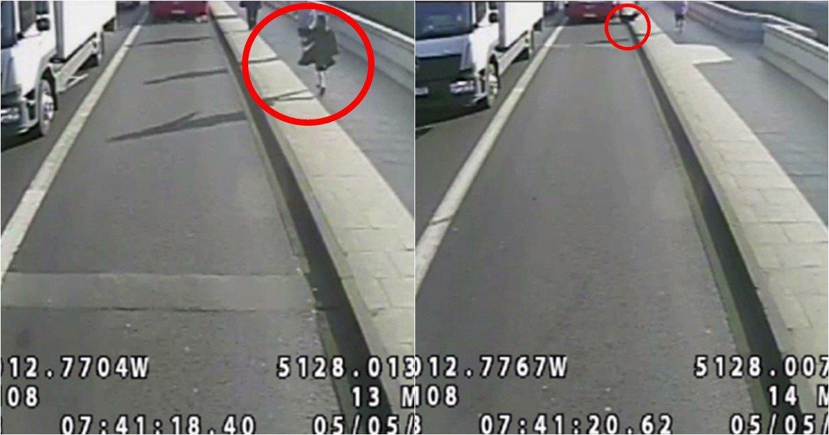 ss - Hombre empuja a mujer corriendo a la carretera (video)