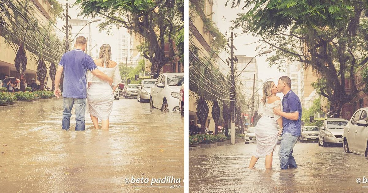 thumbnail5giu9.png?resize=1200,630 - Amor até debaixo d'água: Noivos fazem ensaio fotográfico de casamento em uma rua alagada