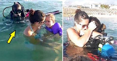 safe image 1 1.jpg?resize=1200,630 - Mother Playing With Her Kids In Water Gets Surprised By A Man In Scuba Diving Suit