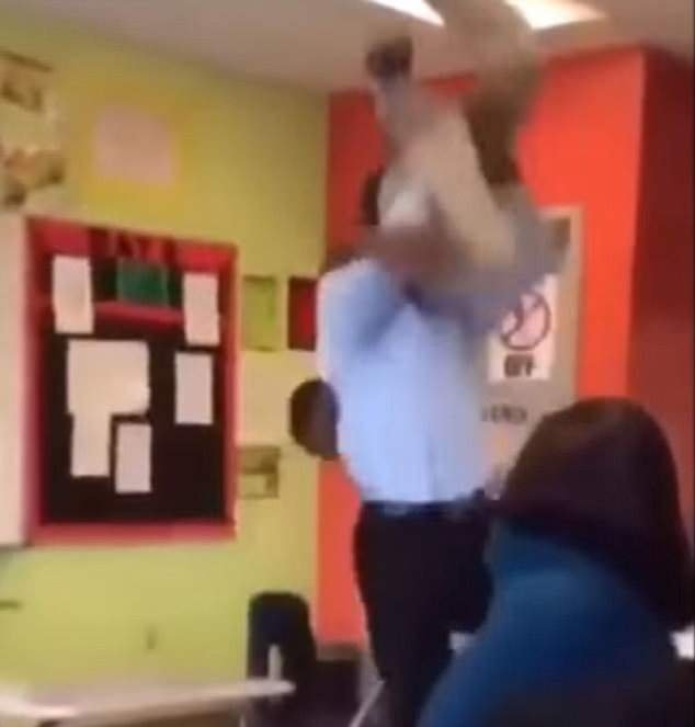 This is the moment the teacher raised the student before slamming him onto a desk