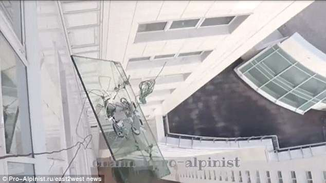 A cable snapped as the construction workers wearing GoPro cameras were used to fix the window unit into the skyscraper.