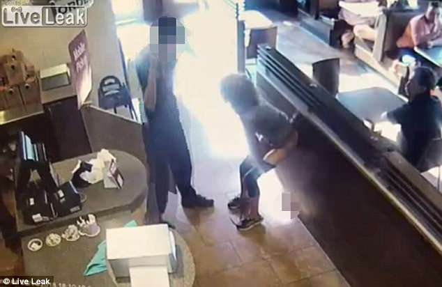 The employee is seen standing next to her as he calls his police, but quickly moves away when the feces dropped (muzzed on the floor)