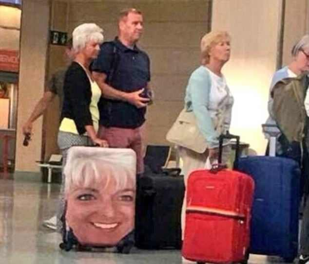 The trend got another boost this week when a middle-aged woman was snapped waiting at an airport sporting her smiling face on her suitcase