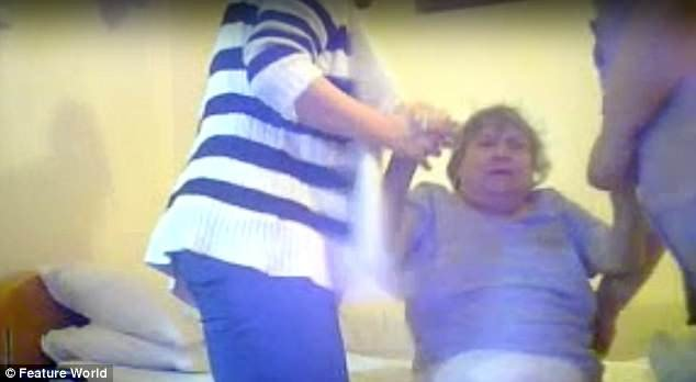 Sickening footage at Brookside House Care Home in Nottinghamshire shows Joy Lewis, 71, being dragged out of bed by her wrists in the early hours of the morning